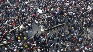 Demonstrators gather near Cairo's Tahrir Square on Saturday in defiance of the Mubarak government's curfew.