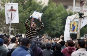 Egyptian Christians protest outside the Al-Qiddissine (The Saints) church following a January 1 car bomb attack