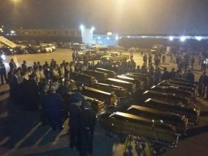 The remains of 20 Egyptians Coptic Christians and one citizen from Ghana arrive at Cairo airport a few hours earlier