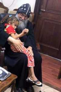 Bishop Makarios of Minya comforting one of the young victims of the recent attacks near Minya.